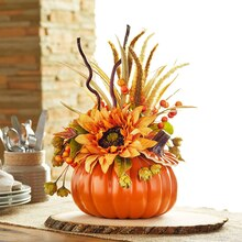 fall pumpkin floral arrangement on table
