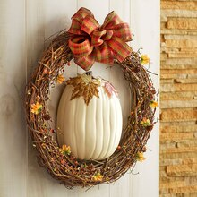 fall pumpkin wreath on wall