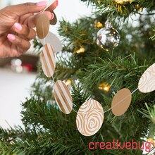 Gold and White Paper Punched Tree Garland, medium